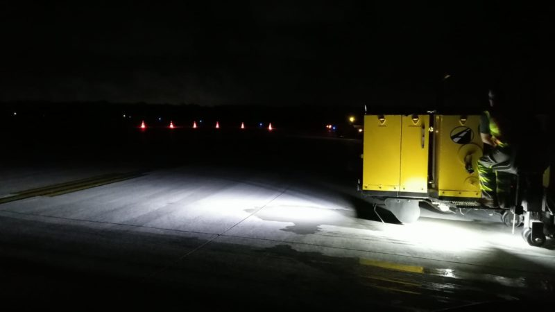 airfield grooving machine at night