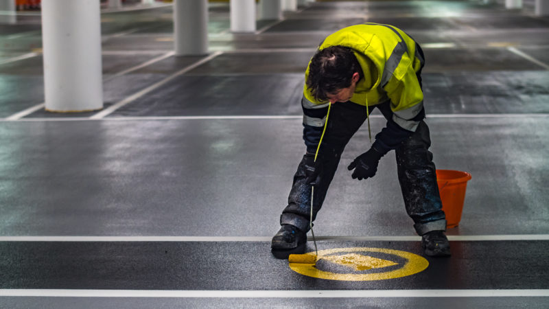 car park marking by hand